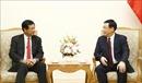 Phó Thủ tướng Vương Đình Huệ chia sẻ kinh nghiệm phát triển hợp tác xã với nguyên Thủ tướng Lào