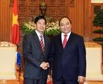 Việt Nam coi trọng phát triển quan hệ với Lào