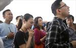 Gia đình nạn nhân máy bay AirAsia bắt đầu nhận tiền bảo hiểm
