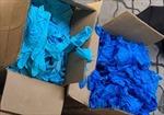 Giám định gần 2.000 thùng găng tay cao su bẩn mốc