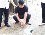 Bắt quả tang Thiếu úy công an nhận hối lộ của người đánh đề