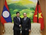 Thủ tướng Nguyễn Xuân Phúc tiếp, hội đàm với Thủ tướng Lào Thongloun Sisoulith