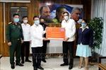 Trao thư, điện và quà mừng của Lãnh đạo Đảng ta gửi Lãnh đạo Đảng Cộng sản Cuba