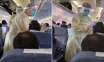 Nhân viên y tế kiểm tra thân nhiệt từng hành khách trên máy bay tại Vũ Hán