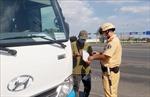 Cảnh sát Giao thông đảm bảo ATGT và chủ động phòng, chống dịch COVID-19
