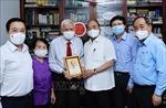 Chủ tịch nước thăm một số nhà báo, gia đình nhà báo lão thành nhân Ngày 21/6