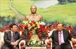 Tổng Bí thư, Chủ tịch nước Lào tiếp Giám đốc Học viện Chính trị quốc gia Hồ Chí Minh