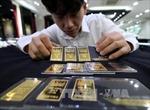 Giá vàng châu Á nhích lên do lo ngại kinh tế Mỹ suy giảm