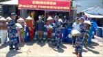 Cảnh sát biển đồng hành với ngư dân miền Tây chống hạn mặn và dịch COVID-19