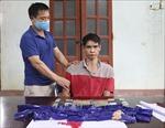 Bắt đối tượng mua bán trái phép 4 bánh heroin và 6.000 viên ma túy tổng hợp