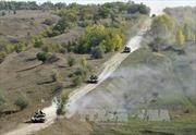 Ukraine dọa ngừng rút vũ khí hạng nặng khỏi tiền tuyến