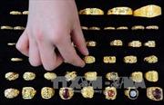 """Giá vàng châu Á chạm """"đáy"""" kể từ năm 2010"""