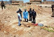 Phát hiện hố chôn hàng loạt nạn nhân bị bắn vào đầu ở Đông Aleppo