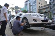 Chùm ảnh cẩu xe biển xanh giành lại vỉa hè TP Hồ Chí Minh