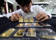 Giá vàng thế giới chạm mức thấp nhất trong một tháng
