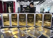 Giá vàng châu Á leo lên mức cao nhất hơn một tuần
