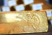 Giá vàng châu Á chạm mức thấp trong tuần