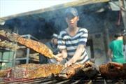 Cá lóc nướng đắt hàng ngày vía Thần Tài