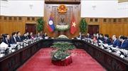 Thủ tướng Nguyễn Xuân Phúc đón chính thức và hội đàm với Thủ tướng Lào Thongloun Sisoulith