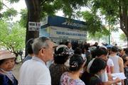 Người dân Thủ đô tấp nập đăng ký thẻ đi xe buýt miễn phí