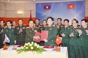 Ký kết văn kiện hợp tác giữa hai Bộ Quốc phòng Việt Nam - Lào