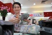 Tỷ giá trung tâm tăng 2 đồng, đồng USD và đồng bảng Anh giảm mạnh