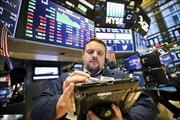Chứng khoán Phố Wall đồng loạt giảm điểm sau cuộc họp của Fed