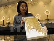 Giá vàng châu Á tăng trước thềm cuộc họp của Fed