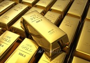 Giá vàng châu Á rơi xuống mức 'đáy'trong một tuần