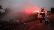 Kịp thời khống chế đám cháy lớn từ bãi rác ngay sát cây xăng
