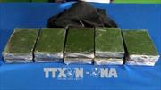 Bắt đối tượng 'ôm' 12 bánh heroin tại biên giới Sơn La