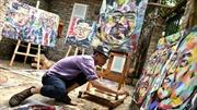 Họa sĩ Hà Nội khắc họa chân dung 'hòa bình' hai nhà lãnh đạo Mỹ, Triều Tiên
