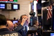 Chứng khoán Âu-Mỹ đồng loạt giảm điểm mạnh