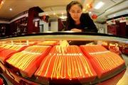 Đồng USD mạnh lên gây sức ép đối với giá vàng châu Á