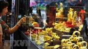 Giá vàng châu Á giảm do hoạt động chốt lời