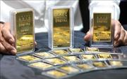 Giá vàng châu Á giảm do đồng USD mạnh