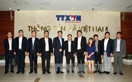 Tăng cường hợp tác giữa TTXVN và Tân Hoa xã