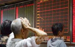 Chứng khoán Trung Quốc tiếp tục đi xuống, đồng NDT lại giảm giá