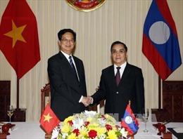 Việt-Lào quyết tâm cao tăng cường mối quan hệ đoàn kết đặc biệt