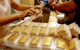 Giá vàng bật tăng rồi hạ nhiệt