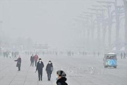 Trung Quốc ban bố cảnh báo sương mù và ô nhiễm không khí