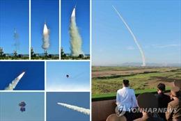 Ông Kim Jong-un lệnh sản xuất hàng loạt vũ khí mới, triển khai dày đặc 'như rừng'
