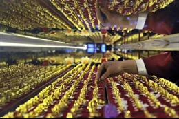 Giá vàng châu Á đi xuống khi đồng USD mạnh lên
