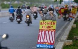 """Mua bảo hiểm xe máy 5.000-10.000 đồng có """"thoát"""" cảnh sát giao thông phạt?"""