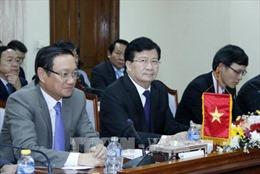 Phó Thủ tướng Trịnh Đình Dũng làm việc về Dự án nhà Quốc hội Lào