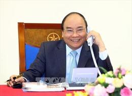 Thủ tướng Nguyễn Xuân Phúc chúc Tết Thủ tướng Lào và Thủ tướng Campuchia