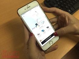 Grab thâu tóm Uber có vi phạm Luật Cạnh tranh?
