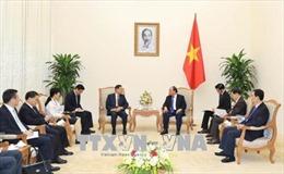 Thủ tướng Nguyễn Xuân Phúc tiếp Chủ tịch Khu tự trị dân tộc Choang, tỉnh Quảng Tây, Trung Quốc
