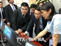 Đẩy mạnh hợp tác giữa Thông tấn xã Việt Nam và Tân Hoa xã