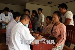 Cộng đồng người Việt chung tay giúp nhân dân Lào khắc phục sự cố vỡ đập